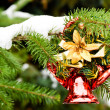 Stock Photo: Christmas bell hanging on pine - tree branch with snow