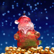 Santa Claus figurine on golden pearls — Stock Photo