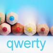 Qwerty text and pencils — Stock Photo