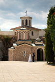 Couple in front of a church — Stok fotoğraf