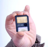 Male hand holding old memory card — Stock Photo