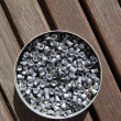 Aluminum can of lead pellets — Stock Photo