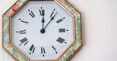 Clock hanging on a wall — Stock fotografie