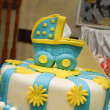 Baby boy birthday cake with cute carriage — Stock Photo