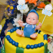 Baby boy birthday cake with cute doll — Stock Photo