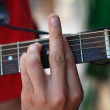 Musician playing old  guitar — Stockfoto