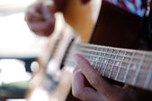 Musician playing old guitar — Stock Photo