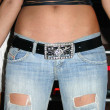 Sexy woman tan belly in jeans with black  belt  — Stock Photo