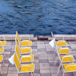 Yellow chairs on riverbank — Stock Photo