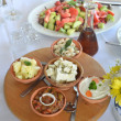 Various salads on wooden platter — Stock Photo