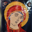 Embroidered fresco souvenir of Mother of God — Stock Photo