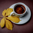Automn espresso  with leaf and beans — Stock Photo