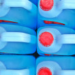 Bottle of blue transparent dish washing liquid — Stock Photo