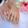 Hands of the groom and the bride — Stock Photo