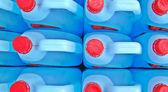 Bottle of blue transparent dish washing liquid — Stock Photo