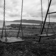 Stock Photo: Swings in a park