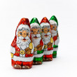 Gift wrapped chocolate Santa Claus — Stock Photo