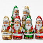 Gift wrapped chocolate Santa Claus — Stok fotoğraf