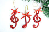 Christmas tree ,details, musical notes, balls... — Stock Photo
