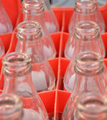 Glass bottles in red crate — Stock Photo