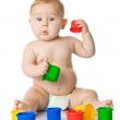 Baby playing with cup toys. Isolated on white background — Stock Photo #13512909