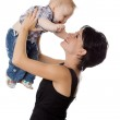 Beautiful happy mather with attractive baby boy on white. Portra — Stock Photo