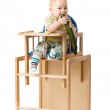 Baby sitting in highchair. — Stock Photo