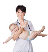 Beautiful doctor and baby on a white background. — Zdjęcie stockowe