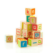 Wooden toy cubes with letters. Wooden alphabet blocks. — ストック写真