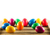 Colorful easter eggs on old wooden background. Easter concept. — Stock Photo