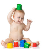 Baby playing with cup toys. Isolated on white background — Stock Photo