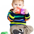Baby is playing with toys over white background. Funny little k — Stock Photo #21731183