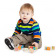Baby playing with wooden toy cubes with letters. Wooden alphabet — Stock Photo #21731279