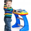 Little boy and the keyboard on white background. funny boy baby. — Stock Photo #21731391