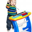 Little boy and the keyboard on white background. funny boy baby. — Stock Photo #21731403