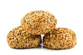 Round wholemeal bread. resh buns with different seeds. — Stock Photo