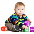 Baby is playing with toys over white background. Funny little k — Stock Photo