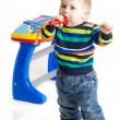 Little boy and the keyboard on white background. funny boy baby. — Stock Photo #22509851