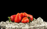 Strawberry on black background. strawberries with ice cubes on — Stock Photo
