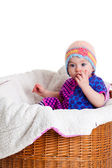 Baby Girl Sitting in the Basket. — Stock Photo