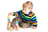 Baby playing with wooden toy cubes with letters. Wooden alphabet — Stock Photo
