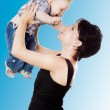 Beautiful happy mather with attractive baby boy. Portrait of bab — Stock Photo