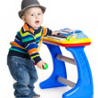 Little boy and the keyboard on white background. funny boy baby. — Stock Photo #23898449