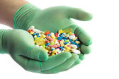 Hand with pills. Many colorful pills on two hands — Stock Photo