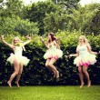 Beautiful happy young women jumping. — Stock Photo