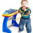 Little boy and the keyboard on white background. funny boy baby. — Stockfoto #24867385