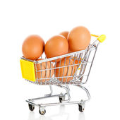 Eggs in the shopping cart isolaten in white. Brown eggs in the b — Stock Photo
