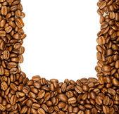 Kahve sınır. beyaz arka plan üzerinde izole kahverengi kahve çekirdekleri. — Stok fotoğraf