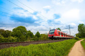 Train in motion. Modern red train — Stock Photo