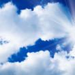 Blue sky with clouds and sun. White clouds in blue sky — Stock Photo